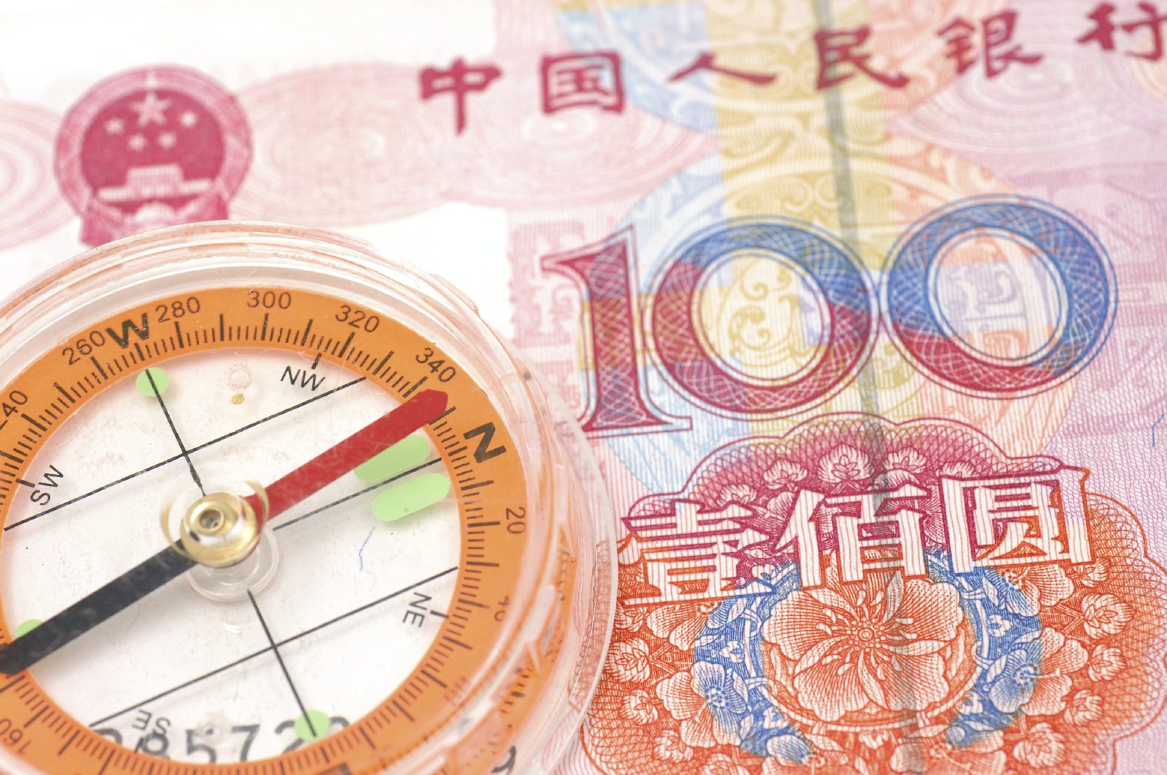 Close up of compass on one hundred renminbi bill