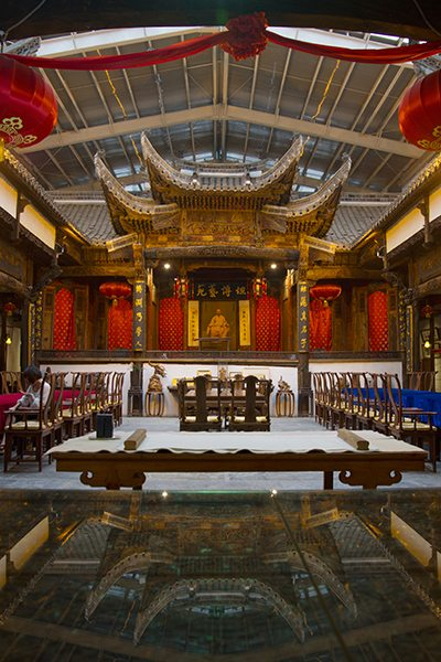 The courtyard of a Huizhou-style mansion preserved inside a glass house