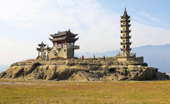 An island temple in a dried-up lake bed